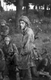 Fallschirmjäger resting in Normandy. June 1944. Photo: Slickers. Bundesarchiv Accession Number: Bild 101I-586-2225-11A