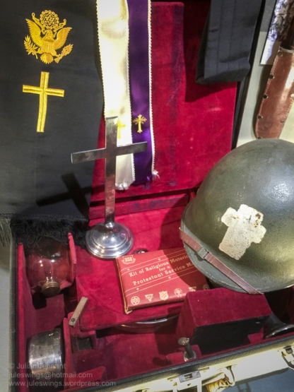 """Display featuring objects belonging to Francis L. Sampson, the 501st PIR's """"Parachuting Padre"""". Photo: Julian Tennant"""