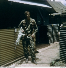 Trooper Don Barnby a Member of Two Five patrol, 2 Squadron, Special Air Service Regiment on SAS Hill, Nui Dat, South Vietnam immediately prior to moving out on patrol. AWM Accession Number: P00966.047