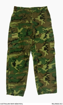 ERDL camouflage trousers : Trooper D R Barnby, 2 Squadron, Special Air Service Regiment. Description: Pair of ERDL camouflaged Ripstop trousers, fitted with olive green plastic buttons. A pair of slash pockets are fitted at the hips. The trousers have a waist band with four belt loops and a concealed button fly closure. The trousers feature a concealed map pocket, with button opening on each thigh. The bottom of each trouser leg has an internal loop of fabric to blouse the trousers. The Ripstop material in the trousers includes nylon threads cross hatched through the cotton base fabric. History / Summary This distinctive camouflage is the ERDL pattern which was developed by the United States Army at the Engineer Research & Development Laboratories (ERDL) in 1948, and was first issued to US special operations units and the Australian Special Air Service Regiment (SASR) operating in South Vietnam from early 1967. This ERDL variation is also known as the brown based 'highland' or 'wet season' type. AWM Accession Number: REL29666.002