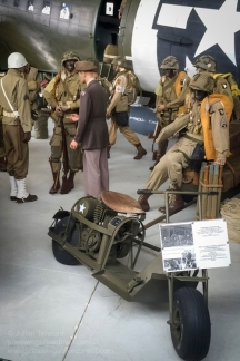 US Army Cushman Airborne Scooter Model M-53 in the foreground of the C-47 display featuring General Dwight D. Eisenhower visiting paratroopers of the 502nd PIR, 101st Abn Div at Greenham Common airfield on 5 June 1944. Photo: Julian Tennant