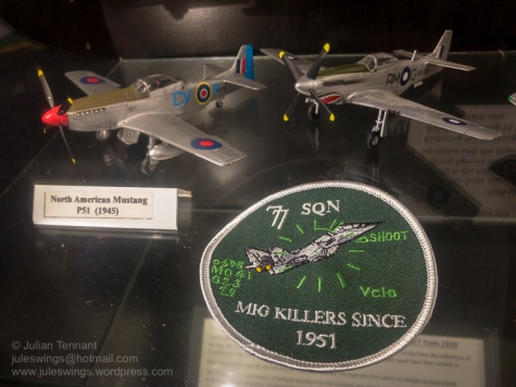 Model aircraft and patch of 77 Squadron RAAF. Photo: Julian Tennant