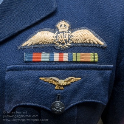 Pilot wings, ribbons and Pathfinder badge on the tunic of Robert Newbiggin who joined the RAAF in 1942 after serving in the Militia. From 1944 - 45 he flew heavy bombers in Europe with 195 and 35 Squadrons RAF, the latter being part of No. 8 Group (Pathfinder Force). Photo: Julian Tennant