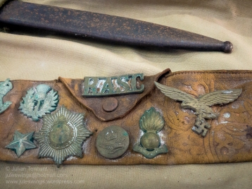 Souvenir belt with various insignia brought back from the North African campaign. Photo: Julian Tennant