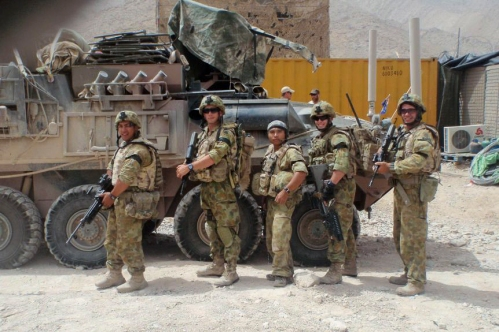 Brian Enad (centre) with fellow soldiers from 6RAR in Afghanistan. Photo courtesy of Brian Enad.