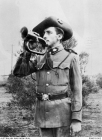 Outdoor portrait of Bugler Ernest Walter Welsman, a carpenter from Kalgoorlie, WA, taken while he was serving in the militia in the West Australian Goldfields Regiment. Welsman later served in the First World War as a private, service number 731, in C Company, 11th Battalion, AIF. He embarked on HMAT Ascanius on 2 November 1914. He was killed in action on 13 July 1915 on the Gallipoli peninsula. Australian War Memorial Accession Number: P08618.002