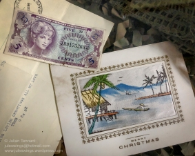 Five cent Military Payment Certificate (MPC) currency note and Christmas card. Photo: Julian Tennant