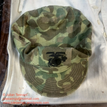 Described as a WW2 US Marine Corps fatigue/field cap, this is in reality a fantasy /fake piece. The Marine Corps actually wore the early short brimmed Army HBT cap in olive drab until the latter part of the war when they introduced the P44 caps for the marines. Futhermore, the camo in WW2 was printed on the same army HBT material for both Army and Marine Corps. This cap has the repeating chevron throughout which, I have been informed, is a sign of the reproduction camo material. Photo: Julian Tennant
