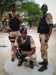 Policemen from the Nampol Special Reserve Force Division pose for a photograph. Note the distinctive SRF camouflage and black berets.