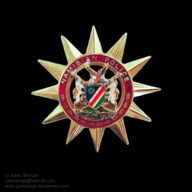 Namibian Police cap badge as worn on the black beret of the Special Reserve Force.