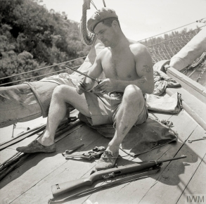 SBS in the Aegean, 1944. Corporal Aubrey of the Special Boat Service sharpens his fighting knife as he prepares for combat. Photograph: IWM collection. Original Source: http://www.iwm.org.uk/collections/item/object/205194966