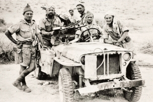 Members of the Long Range Desert Group (LRDG) with a jeep armed with twin Vickers Class K-guns, 1942. The LRDG worked closely with the SAS in their early days, using the LRDG's knowledge of the desert and vehicles to assist with infiltration and extraction tasks.