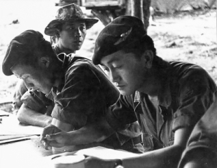 """Thai PARU instructors going over the morning's training programme for their Lao recruits at Hua Hin. Photo: J. Vinton """"Vint"""" Lawrence"""