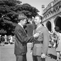 Government House, Sydney, NSW. 23 April 1971. It was a proud day for David Shilston of Wagga Wagga, NSW, when his father, Captain Peter Shilston was presented with the Military Cross (MC) by the Governor of NSW, Sir Roden Cutler, at Government House recently. Captain Shilston was awarded the MC in recognition of his exceptional bravery and leadership in Vietnam while serving with the Australian Army Training Team Vietnam (AATTV). Photo: Barry Buckley. AWM Accession Number BUC/71/0213/EC