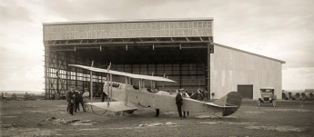 The NSW State Aviation School July 21, 1916, just before officially opening. Timber for the western annexe of the hangar still lies stacked on the ground, as the first Curtis 'Jenny' trainer aircraft is checked out by Chief Instructor Billy Stutt (nearest camera) and the workers who had assembled and rigged the airframe. Hurried patches in the aerodrome surface indicate the pace of preparations towards the official opening of the School on August 28, 1916. Picture: www.3squadron.org.au. Charter Family Collection