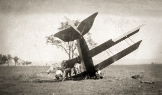 NSW State Aviation School Curtiss Jenny JN4 training aircraft after a crash whilst being flown by K.A. Hendy. November 1918. Source: Collection of photographs of WWI NSW State Aviation School, Museum of Applied Arts & Sciences.