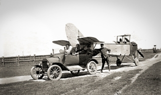 """One of the NSW State Aviation School's """"Jennies"""" returns to the base during WW1, after a crash-landing. Photo courtesy: 3 Squadron RAAF Association www.3squadron.org.au"""