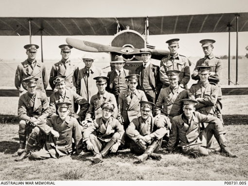 Richmond, NSW. 1917. Probably Australian Flying Corps (AFC) trainees and instructors of the NSW Aviation School in front of a Curtiss Jenny (JN) aircraft at Ham Common near Richmond. Back row, left to right: S. C. Francis; Alfred C. (Alf) Le Grice; David Reginald (Reg) Williams; William John (Billy) Stutt; Richard Henry Chester; F. C. Collins; L. C. Royle. Middle row: J. H. Summers; Derek Hudson; Brian Lucy; Burton B. Sampson; Walter Roy Boulton; M. A. Watts. Front row: H. G. Murray; Lewis Audet; Gordon Vincent Oxenham (later posted to 1 Squadraon AFC and shot down and killed in Palestine on 27 June 1918. He has no known grave and is commemorated on the Jerusalem Memorial, Israel: W A. McDougall. AWM Accession Number: P00731.005