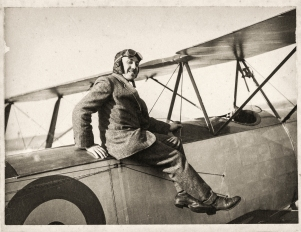 Captain William 'Billy' John Stutt (1891-1920), the NSW State Aviation School's chief instructor, sitting on one of the two American Curtiss trainers. Captain William 'Billy' John Stutt (1891-1920) was the Richmond flying school's chief instructor. Born in Hawthorn, Victoria, he was an engineer by trade. After completing his flying training at the Bristol School, Salisbury Plain, England, Stutt became a distinguished pilot, flying across the English Channel 40 times as the first King's Messenger, and was appointed Chief Test Pilot at the Royal Aircraft Factory at Farnborough in 1915. He was released from military duties in London to take up the position of Chief Pilot at the NSW flying school in 1916. He was an inspirational leader, greatly admired for his flying skills and rapport with his students. Stutt was also a tireless promoter of aviation, flying many daring demonstrations for dignitaries, the press and the public. He used one of the flying school's Curtiss Jenny JN-4B aircraft to fly from Sydney to Melbourne in November 1917, despite becoming lost in fog and other misadventures, to promote flying as a 'post-war transport prospect'. The return trip on 12th November 1917 was the first one-day flight between capital cities in Australia. In July 1919 he left the School to take up the position of Officer-in-charge, Aeroplane Repair Section, at the Central Flying School at Point Cook, Victoria. Stutt's death was officially recorded as the 23rd of September 1920, when he was tragically lost at sea with Abner Dalziell after their plane disappeared during Australia's first air-sea rescue flight, searching for the missing schooner, 'Amelia J', in Bass Strait. Source: Collection of photographs of WWI NSW State Aviation School, Museum of Applied Arts & Sciences.