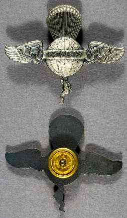 A variation of the Rip Cord Club of the World badge with a screwpost attachment in the Smithsonian National Air & Space Museum. Smithsonian Inventory Number: A19710694118