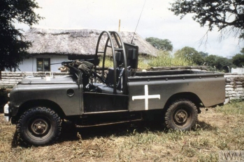 OPERATION AGILA: THE COMMONWEALTH MONITORING FORCE IN RHODESIA 1979 - 1980 (CT 133) A Commonwealth Monitoring Force Landrover equipped with machine gun and roll bar at an Assembly Area. Note the white cross identifying it as a CMF vehicle. Copyright: © IWM. Original Source: http://www.iwm.org.uk/collections/item/object/205124369