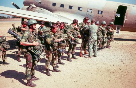 Rhodesian Light Infantry (RLI) 'Fireforce' troops prepare for a parachute drop. The Rhodesian Fireforce regularly used parachute jumps as a method of inserting troops when chasing up terrorists. One Rhodesian soldier, Cpl Des Archer of 1 Commando, RLI remains the world record holder for the most operational jumps (74) and the lowest drop (200 ft).