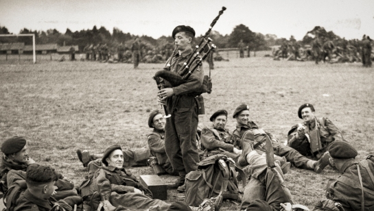 Commando Bill Millin of Lord Lovat's 1st Special Service Brigade playing his bagpipes just before D-Day on 3 June 1944. Photo: War Office official photographer, Evans, J L (Capt)
