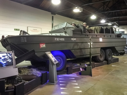 A DUKW amphibious vehicle, Registration 73 YP 44, Chassis 353/15418, Class 3 as displayed at the D-Day Museum in 2015.. It has been given representative markings of A Platoon, 101 Company (Amphibian), Royal Army Service Corps, which served with the British 3rd Infantry Division on D-Day. The history of this vehicle is only known from 1965 onwards, when it was part of HQ Army Emergency Reserve of the RCT (Royal Corps of Transport), then a number of different establishments from October 1965 including the Central Vehicle Depot, Hilton and the Proof & Experimental Establishment, Shoeburyness, before being struck off on 24 October 1974. It is believed to have been one of the last DUKWs left serving with the British Armed Forces.