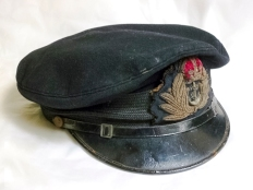 Royal Navy officers cap belonging to Sub Lieutenant John Ellis who was the second in command of Landing Craft Tank 2130. LCT 2130 was an LCT Mk.V and was part of 104th LCT Flotilla. On D-Day LCT 2130 took American troops from Dartmouth in the UK and landed them on Utah Beach around 11.20am. For the next three months it continued to carry troops over to Normandy. Ellis wore this cap on the many journeys his ship made to Normandy.