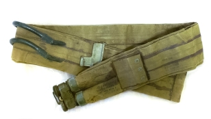 US Army lifebelt recoverd from Omaha Beach. Les Eastwood, a sailor who served on Landing Craft Tank 7057, found this American soldier's lifebelt on Omaha Beach just after D-Day. The life belt consisted of two separate tubes which could be inflated either through blowing into a mouthpiece, or with CO2 cartridges. The CO2 cartridges were in a tube near the buckle, secured by a screw-on cap. To inflate the life belt, two levers fitted inside the belt forced the cartridges into the sharp points on the insides of the caps which pierced them and released the gas into the tubes. The life belt had to be worn higher than the waist, otherwise the weight carried on a soldier's upper body might cause him to turn upside down, with potentially fatal results. These life belts were sometimes also tied to items of equipment such as mortars, Bangalore torpedoes etc. to help them float in case they were dropped in the water during the landings.