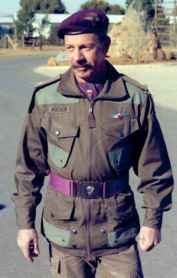 Lt Col. J.H. Kieser, (pictured here whilst still a Major) served as the Officer Commanding Parachute Training Centre from 1 January 1995 to 30 June 1999. Here he can be seen wearing the Freefall Instructor's wing on his 'slangvel' (para smock).