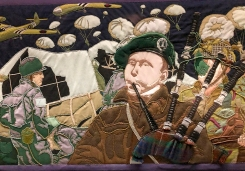 Detail of the Overlord Embroidery showing Lord Lovat's piper Bill Millin of the 1st Special Service Brigade in the foreground with American paratroopers behind.