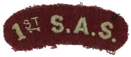 1st SAS cloth shoulder title belonging to Fred Casey. This example achieved a hammer price of £660 at the Bosleys auction in 2020.