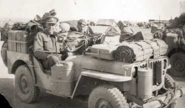 """Photo of Fred Casey's 'L' Detachment SAS comrades in a jeep laden with stores at base camp. Photo"""" Fred Casey."""