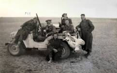 Members of Fred Casey's patrol from 1 SAS posing for a photo after hunting impala in North Africa, 1942. Fred Casey is on the front bonnet.
