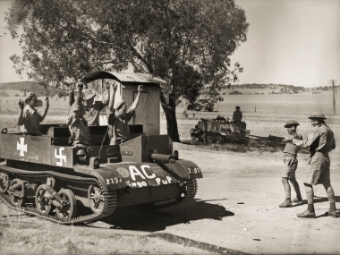 Geraldton, Australia. October 1942. Members of the defending 'forces' in an Exercise ROBBER BARON carried out by the 2nd and 4th Australian Divisions, capture an enemy tank (represented by a Bren Gun Carrier) and its crew. The exercise, which lasted six days and aimed to teach survival skills was one of several large training exercises held in the early years of the war. Australian War Memorial Accession Number: 028679
