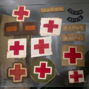 Australian Army Medical Women's Service (AAMWS) insignia. The Australian Army Medical Women's Service (AAMWS) grew out of the volunteer Red Cross and St John Ambulance Voluntary Aid Detachments (known as the VADs). From December 1942 nearly 8,500 AAMWS served as nurses, nursing aides, and technicians tending sick and wounded soldiers in the Middle East, New Guinea, and Australia. The AAMWS served alongside army nursing sisters in hospitals. Photo: Julian Tennant